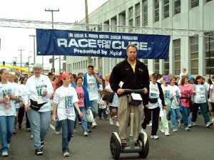 """Riding a Segway in the annual """"Race for the Cure"""""""